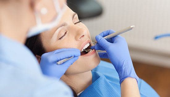 Relaxed woman receiving dental treatment